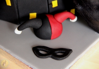 Batman themed frondant birthday cake with Bat symbol and Batman mask