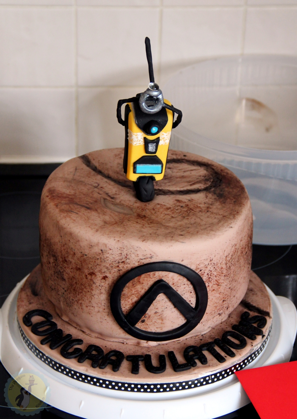 Borderlands themed engagement cake with Claptrap fondant cake topper