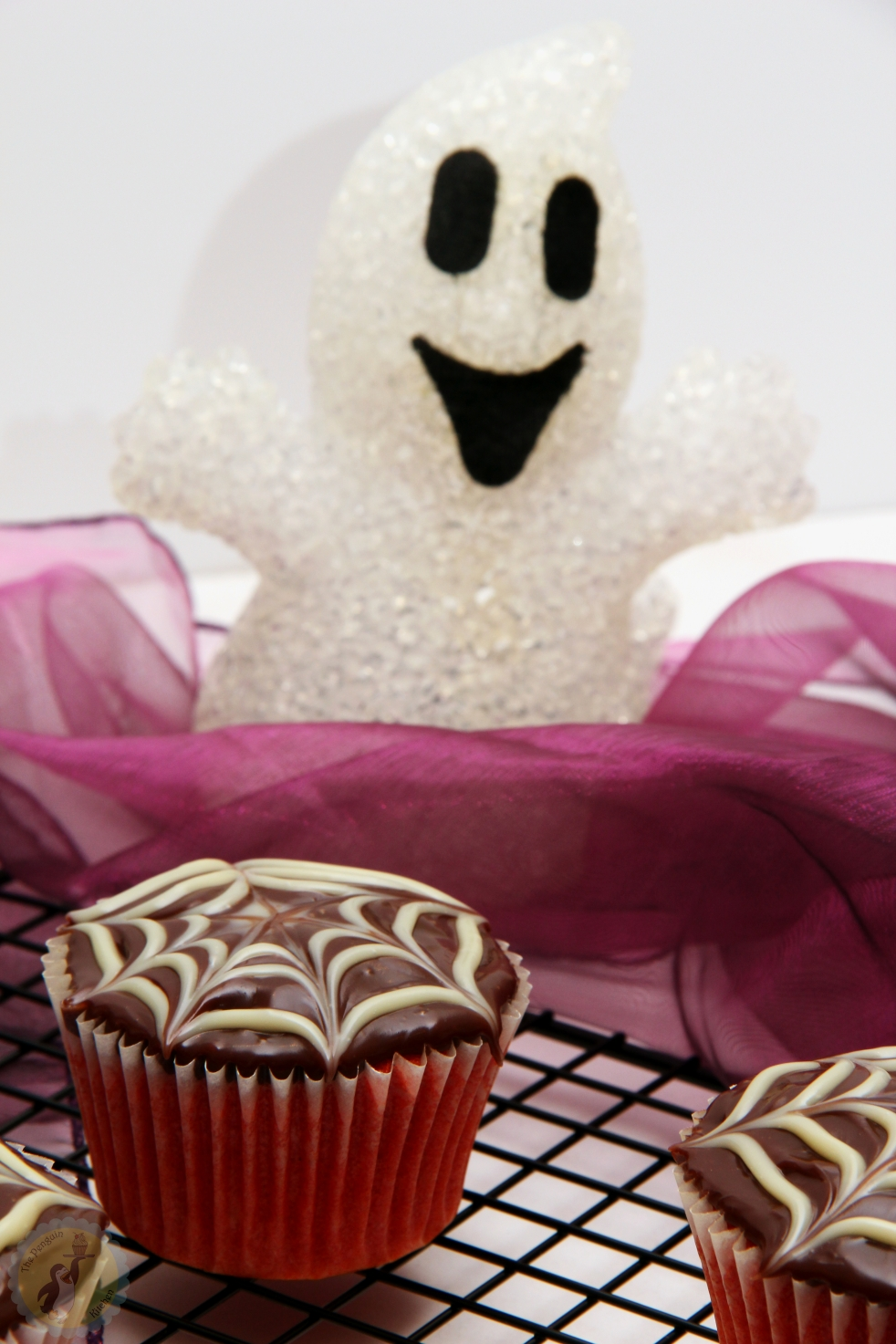 Halloween Cupcakes with chocolate ganach spider web