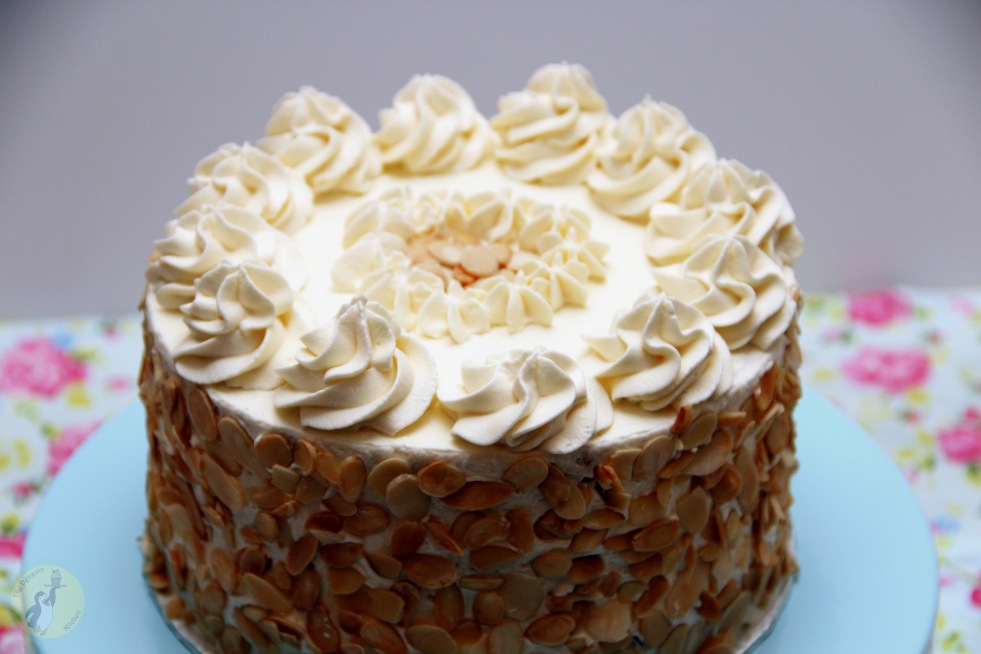 German Amaretto Cream Cake - Vanilla and chocolate cake layers, Amaretto whipped cream, decorated with toasted almonds and cream swirls